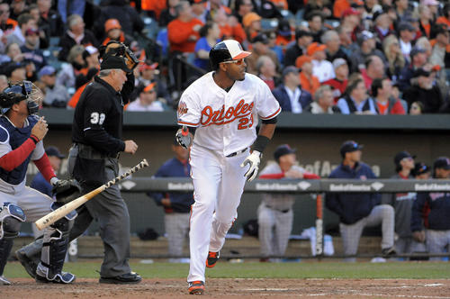 Orioles left fielder Nelson Cruz flips his bat and watches his solo home run in the seventh inning against the Boston Red Sox.