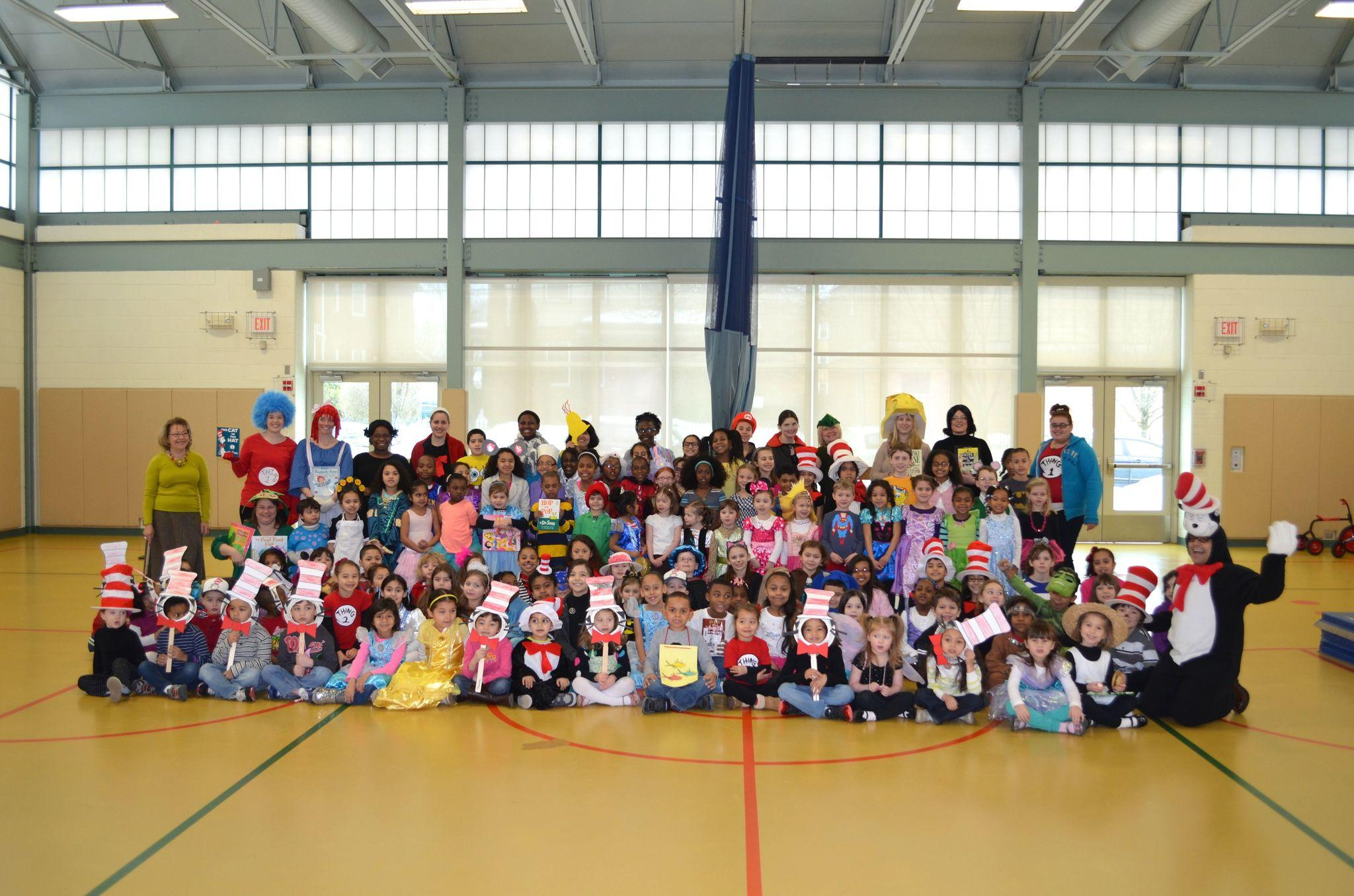 Students and staff of the CREC Montessori Magnet School show off their costumes for Read Across America Day.