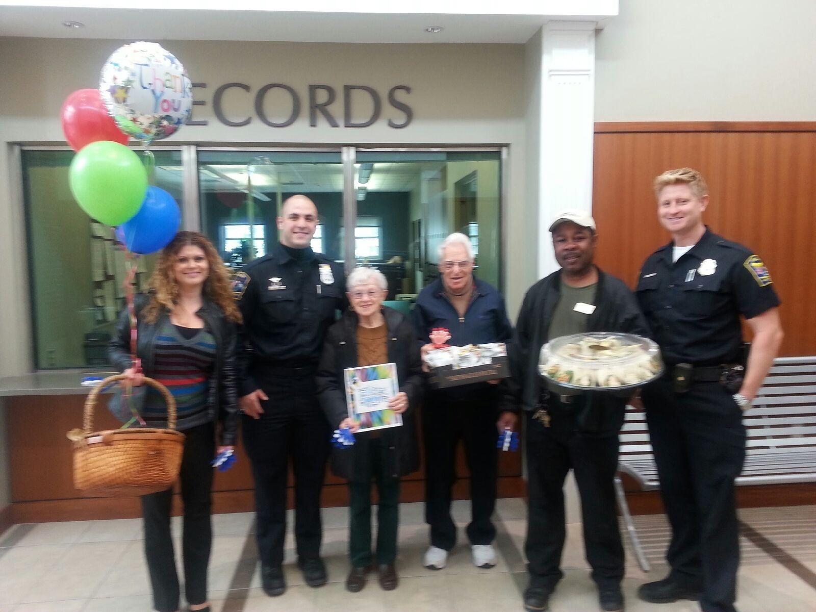 From left to right: SummerWood Membership Specialist, Anabela Ferreira; West Hartford Police Officer, Aaron Vafiades; SummerWood residents, Rose and Fred Gutwill; SummerWood Environmental Services Manager, Clenbert Senior; and West Hartford Police Officer, Sean Dibella.