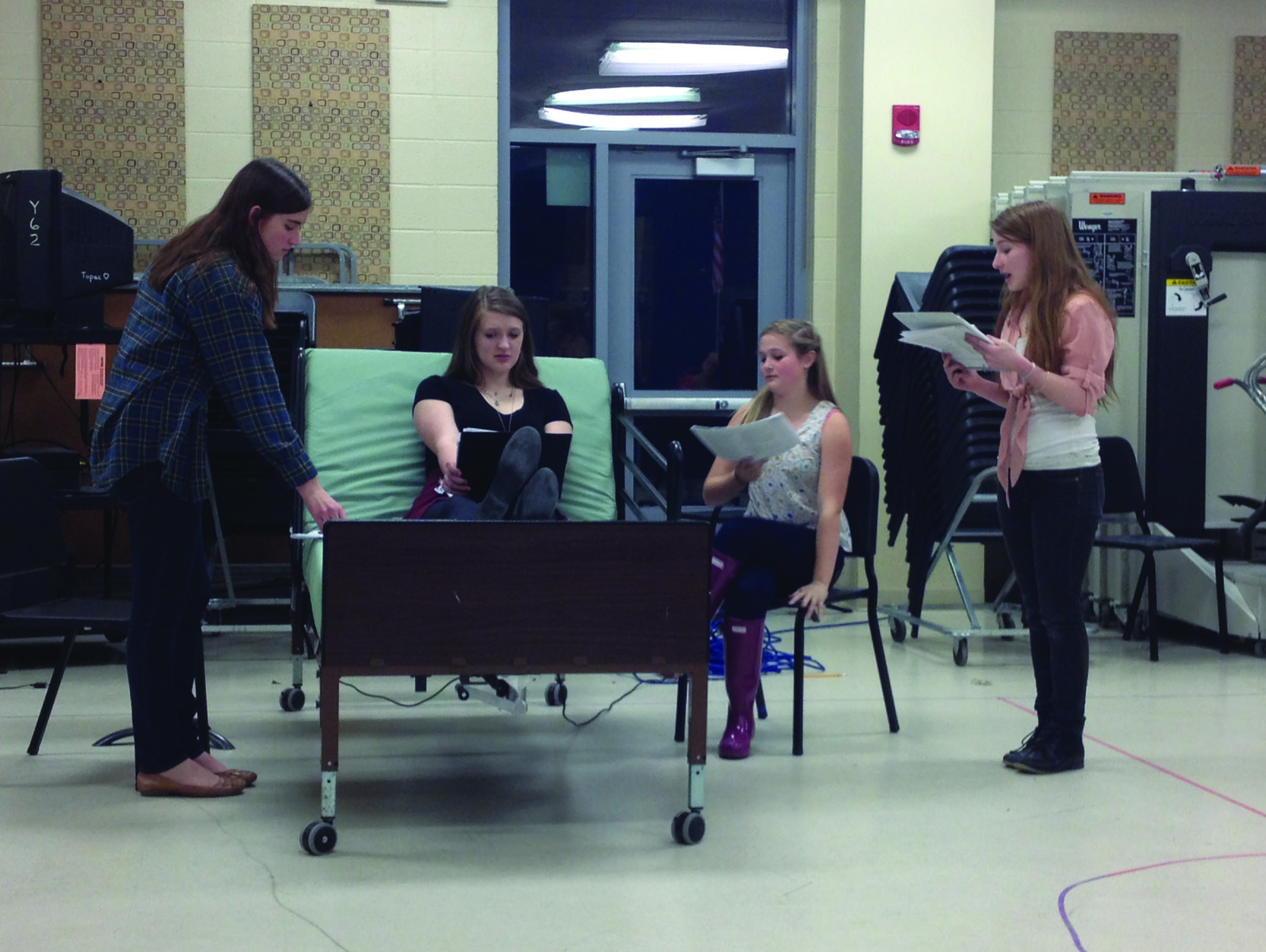 "Kerrie Maguire, Jessica Pomeroy, Sarah Ursini, and Emily Galbraith rehearse the play ""Whose Life Is It Anyway?"" in the Chorus Room at Simsbury High School."