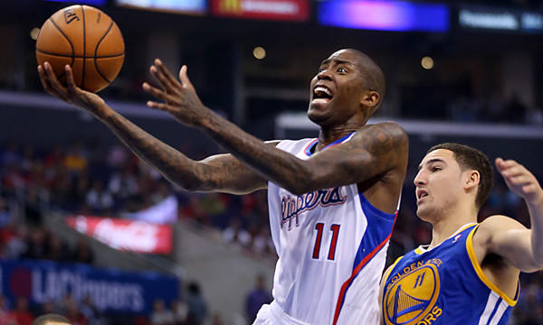 Clippers guard Jamal Crawford puts up a shot in front of Golden State Warriors guard Klay Thompson during a game on Oct. 31.