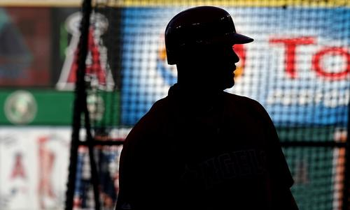 Angels first baseman Albert Pujols takes part in batting practice before the start of the team's 2014 season opener against the Seattle Mariners at Angel Stadium.