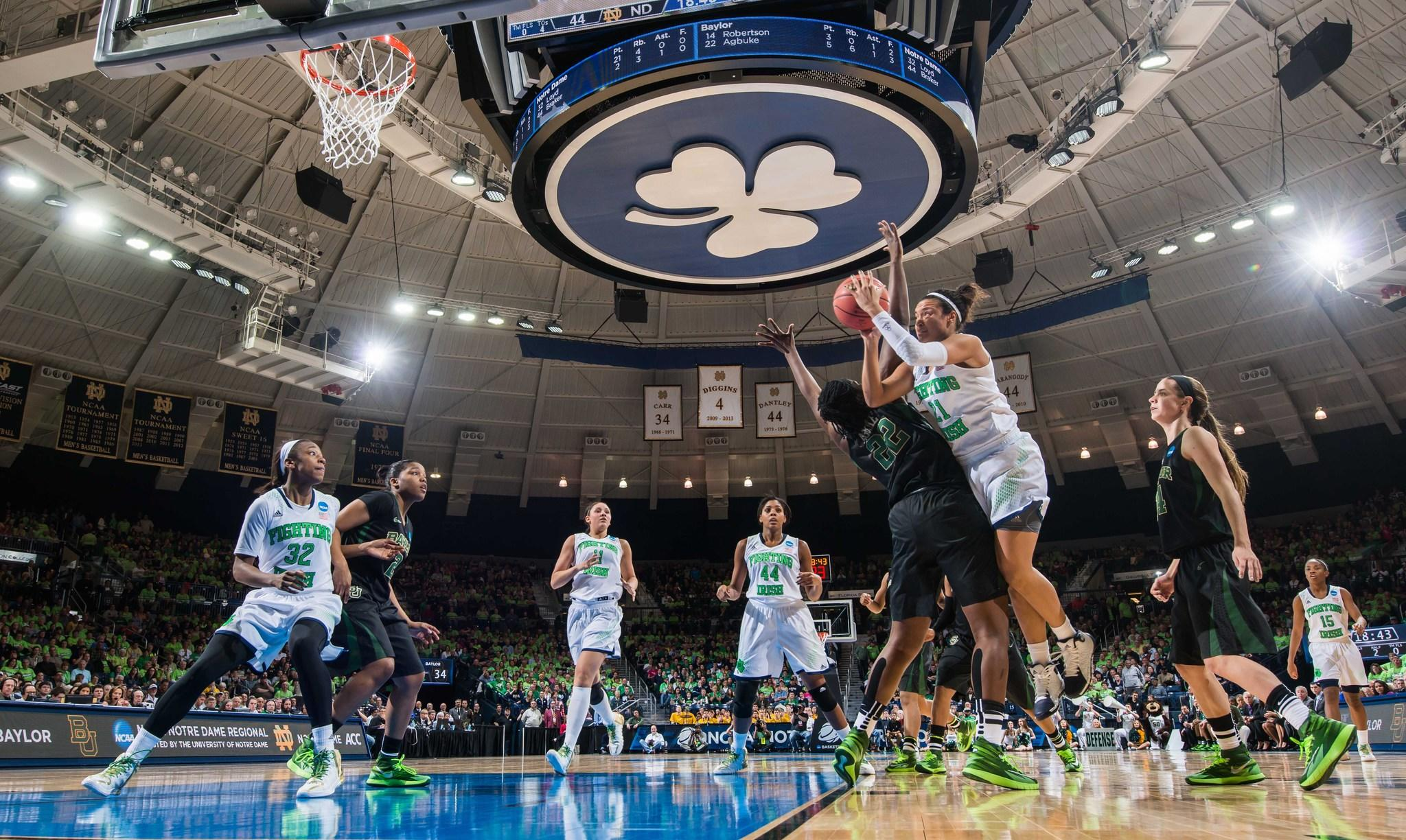 Notre Dame guard Kayla McBride goes up for a shot as Baylor center Sune Agbuke defends.