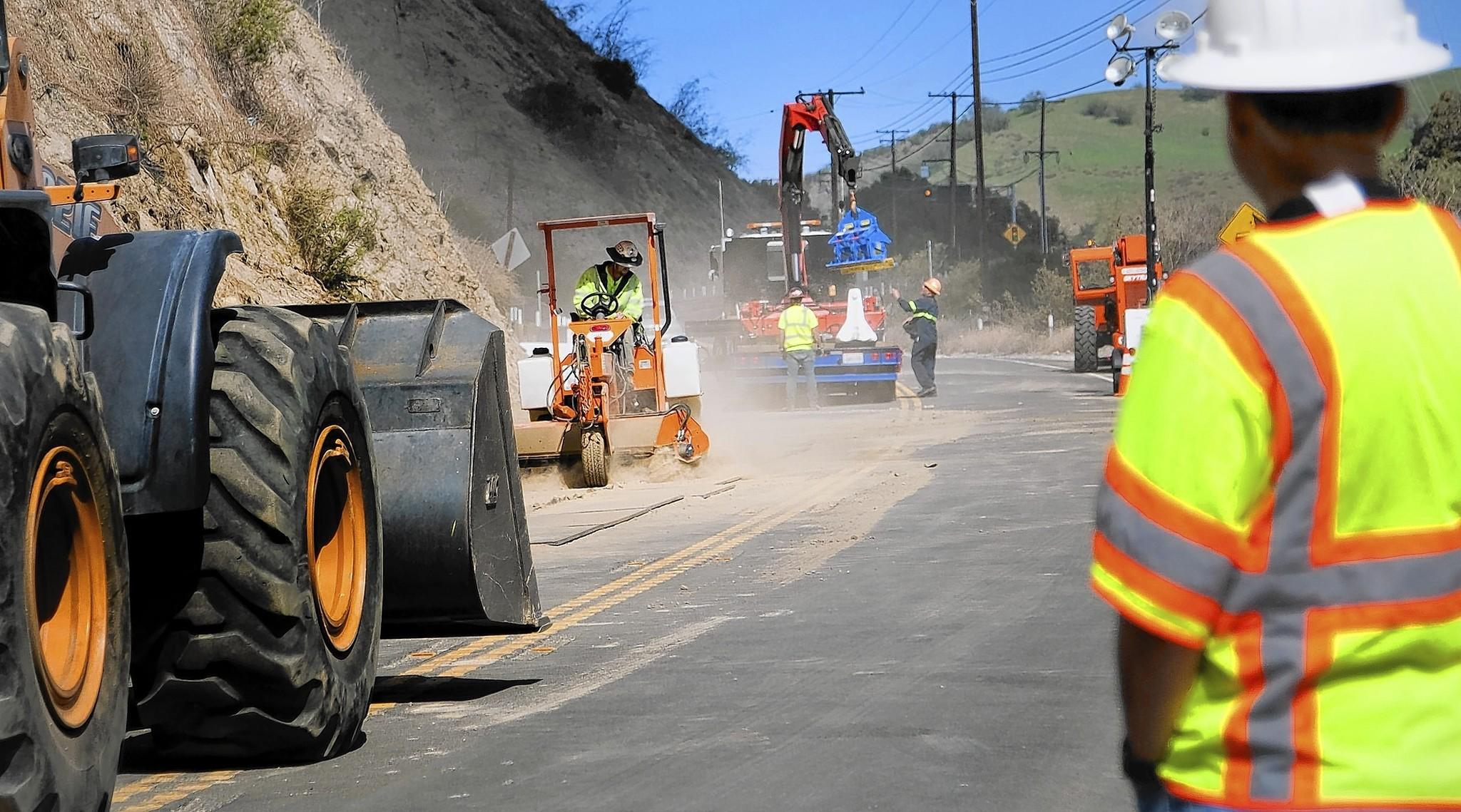 Road crews continue to clean up debris from a rock slide on Carbon Canyon Road in Brea after Friday's earthquake. The road has been closed since Friday night and CalTrans plans to reopen the road at 4 a.m. Tuesday.