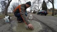 Photos: Pothole art