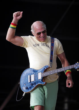 """<b>Jimmy Buffett (Sept. 4-5, 2005): </b> <br><br> Fans outfitted in Buffett-approved """"Parrothead"""" gear - grass skirts, straw hats, beads and coconut bras (and that was just the guys) - invaded Wrigleyville, while the headliner padded around barefoot onstage in lime-green shorts and a Cubs jersey. He covered three songs by Chicago folk legend Goodman, as well as such introspective odes to revelry as """"Why Don't We Get Drunk"""" and """"Cheeseburger in Paradise."""" <br> - Greg Kot"""