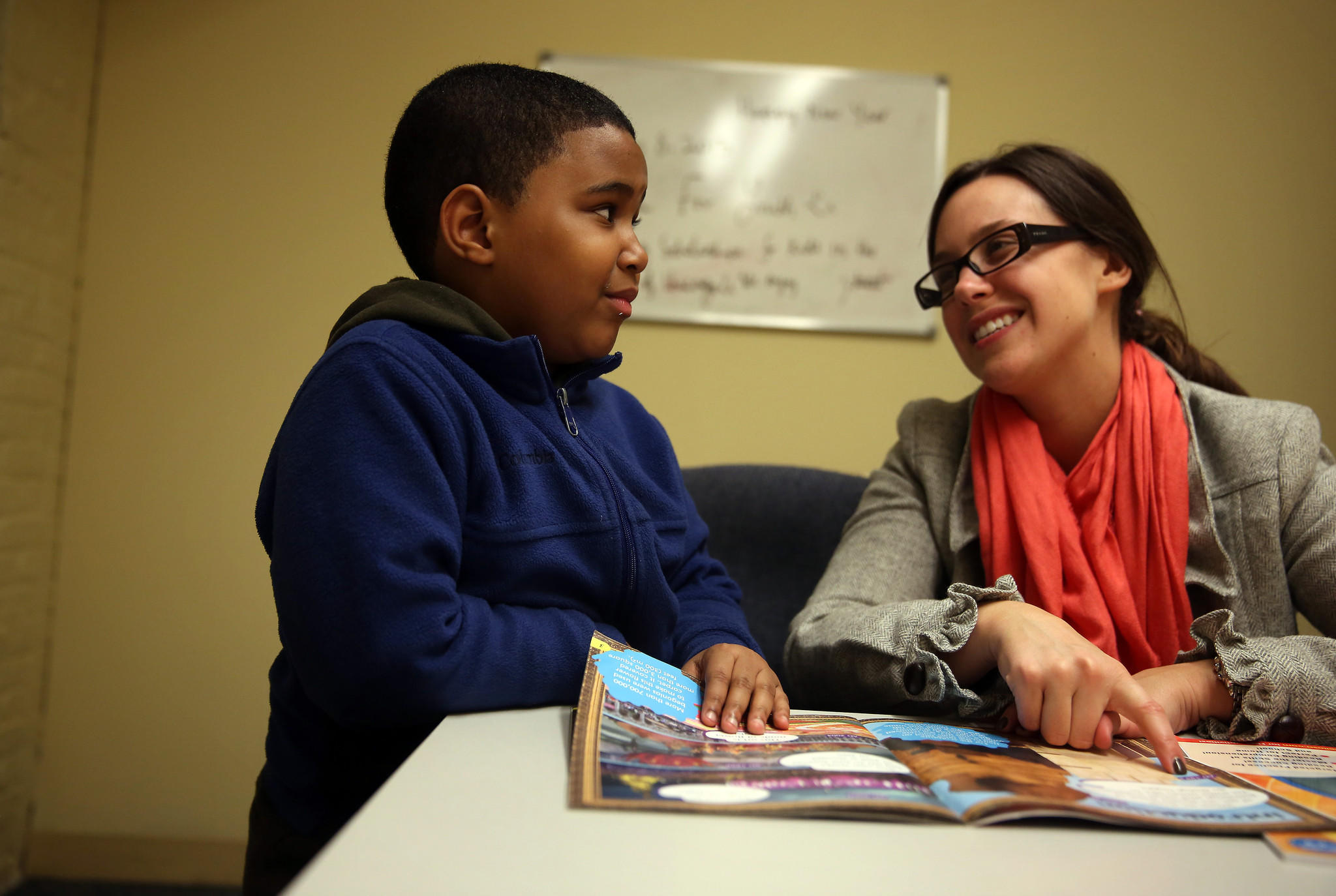 Kelly Powers tutors A.J. McKennie, 6, as part of the Declan's 52 program at Horizons for Youth.