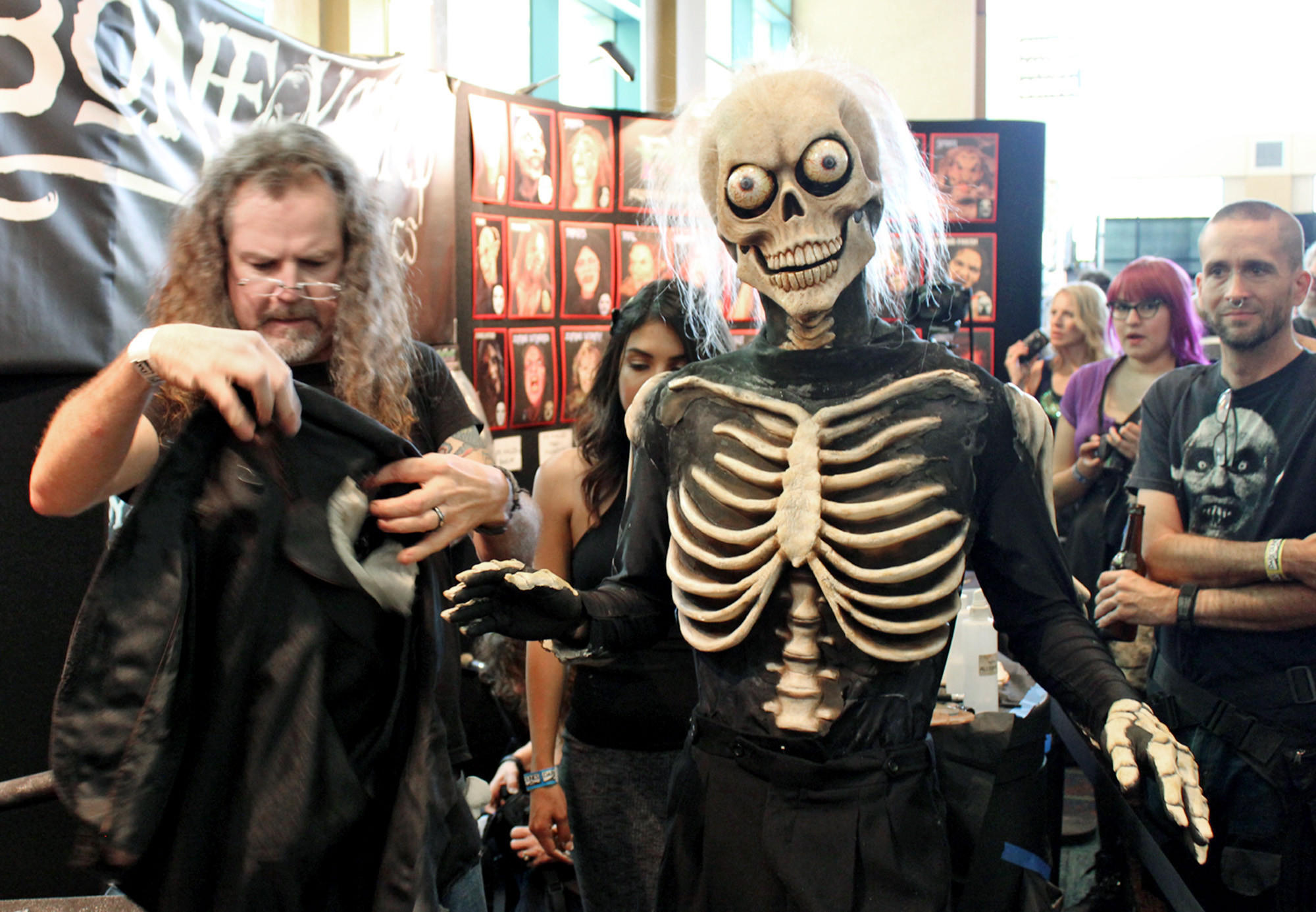 Larry Bones puts the finishing touches on a makeup demonstration at his company's booth at Monsterpalooza.