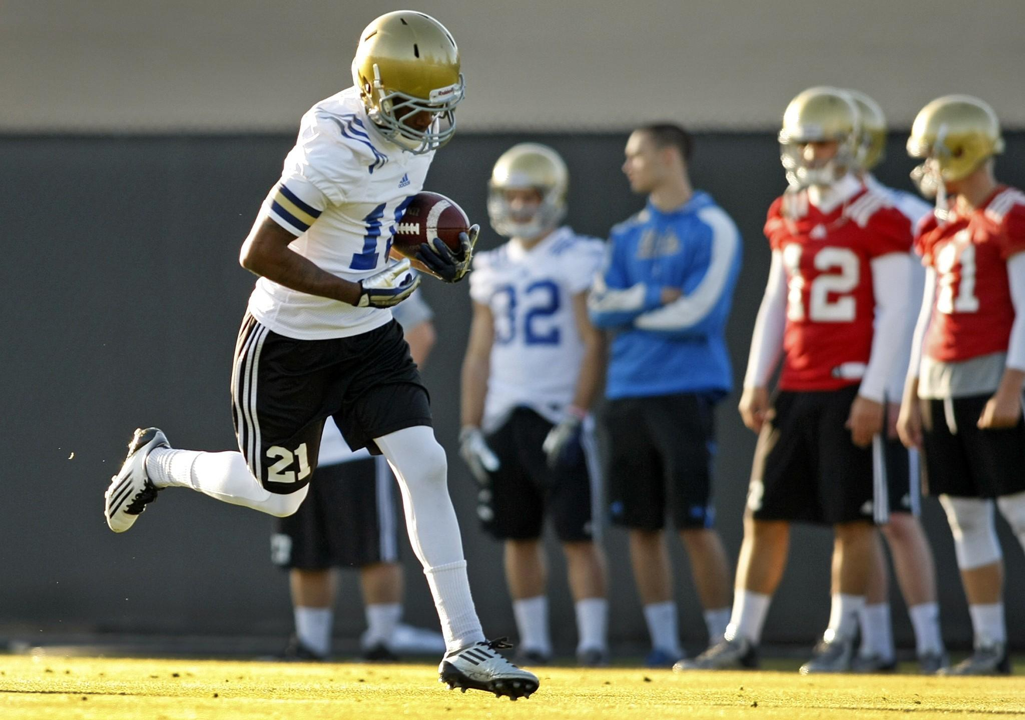 UCLA receiver Kenneth Walker catches a pass on April during the Bruins' first spring practice.