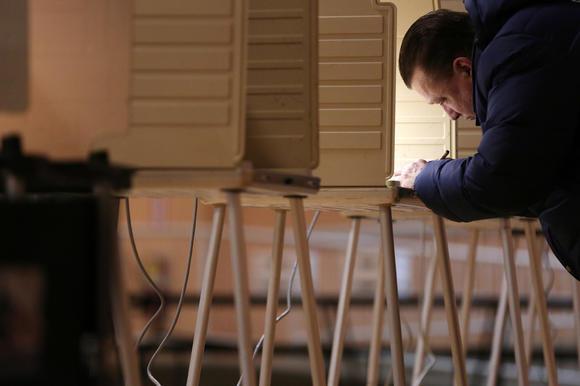Voter Darryl Mrock casts his ballot