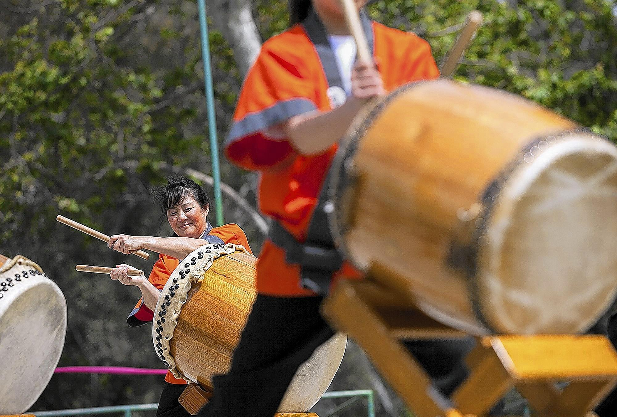 Members of Daion Taiko, from the Orange County Buddhist Church in Anaheim, perform during the Huntington Beach Sister City Japanese Cultural Festival on Saturday in Central Park.