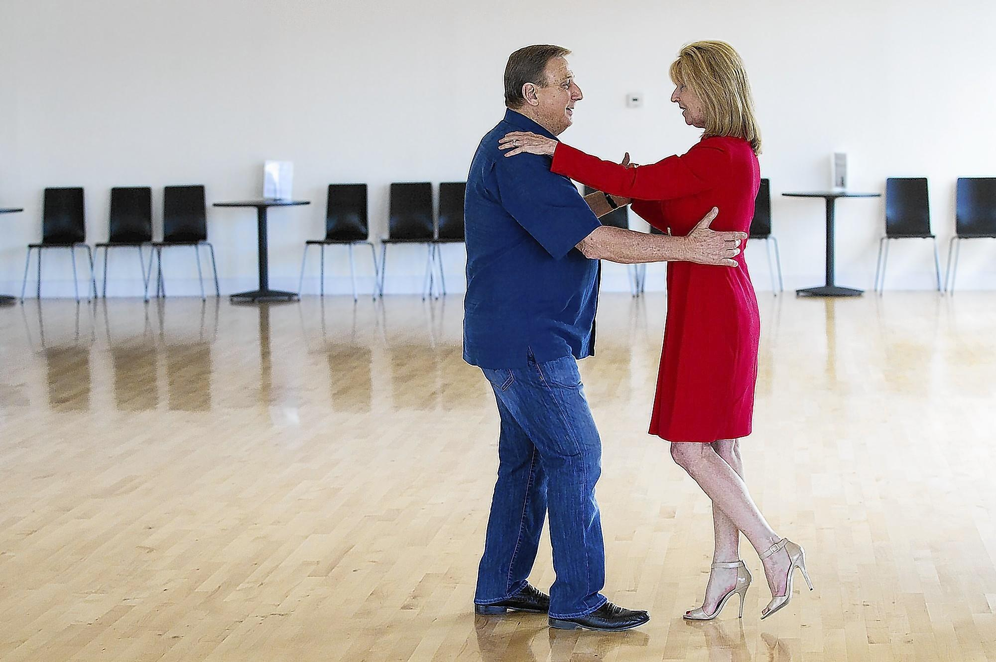 "Huntington Beach City Councilman Joe Carchio rehearses with his fiance Judith Rosser with instruction from Oleg Suvorov at Dance All You Can in Fountain Valley on Tuesday, April 1. The Golden West College Foundation hosts its 17th annual fundraiser with a ""Dancing for the Stars"" theme on Saturday. (Scott Smeltzer - Huntington Beach Independent)"