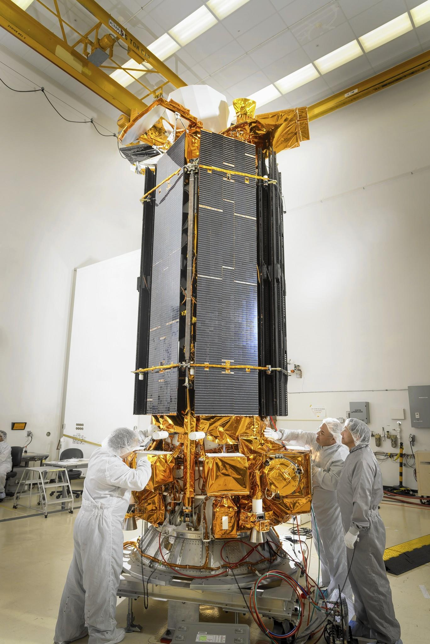 A weather satellite, part of the Defense Meteorological Satellite Program, is prepared for launch at Vandenberg Air Force Base near Lompoc, Calif.