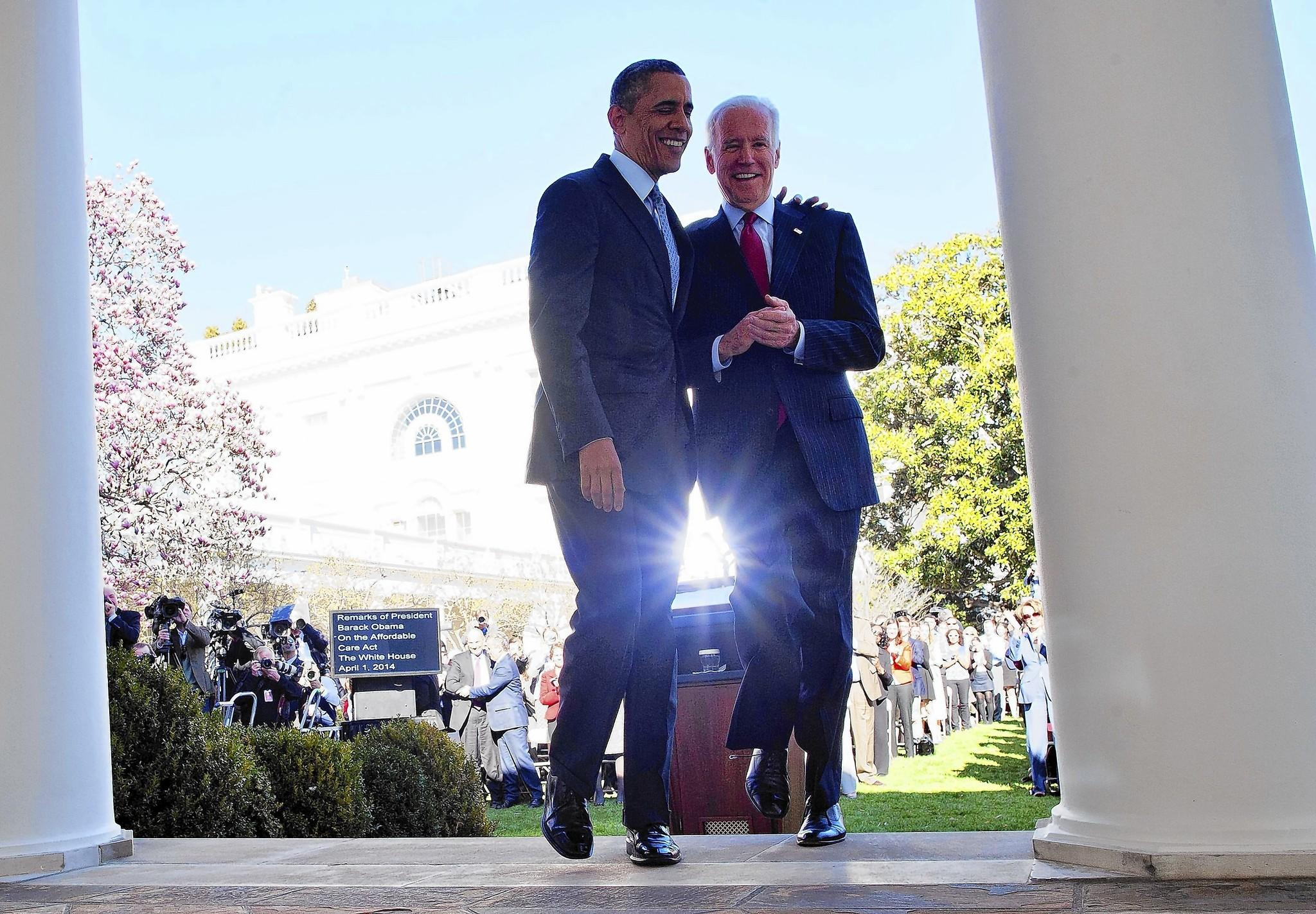 """President Obama walks back to the Oval Office with Vice President Joe Biden after delivering a statement on the Affordable Care Act at the White House Rose Garden. """"This law is doing what it's supposed to do,"""" Obama said, """"all of which makes the lengths to which critics have gone to scare people or undermine the law or try to repeal the law without offering any plausible alternative so hard to understand."""""""