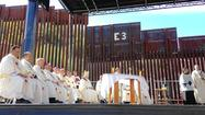 Catholic leaders hold Mass at border to urge immigration overhaul
