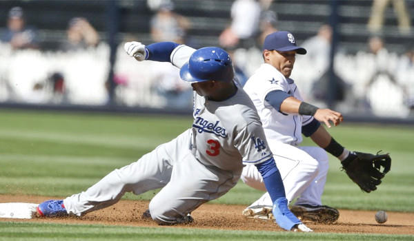 Carl Crawford steals second base and advances to third on a bad throw during the first inning of the Dodgers' 3-2 win Tuesday over the Padres.