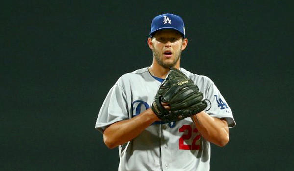 Clayton Kershaw's return to the mound for the Dodgers could be delayed through the entire month of April because of a strained back muscle.