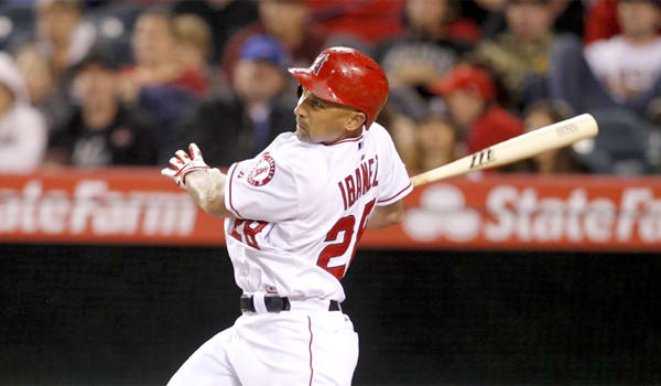 Raul Ibanez hits a two-run home run in the fourth inning of the Angels' loss Tuesday to Seattle, 8-3, at Angel Stadium.