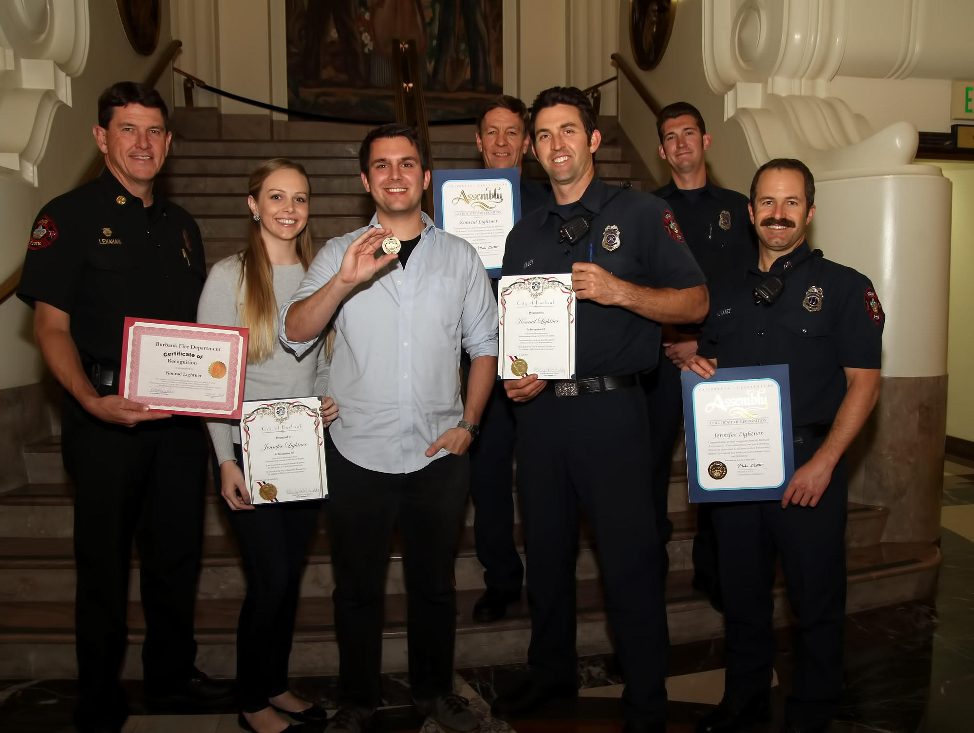 Members of the Burbank Fire Department, along with City Council members, honored Konrad Lightner and his wife Jennifer, after they saved the life of a 3-year-old boy who fell from a third-story window.