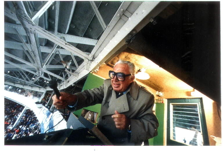 Late Cubs TV play-by-play announcer Harry Caray leads the 7th inning stretch during opening day at Wrigley Field in 1988.