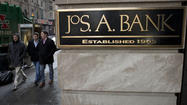 Jos. A. Bank earnings slip on costs related to takeover