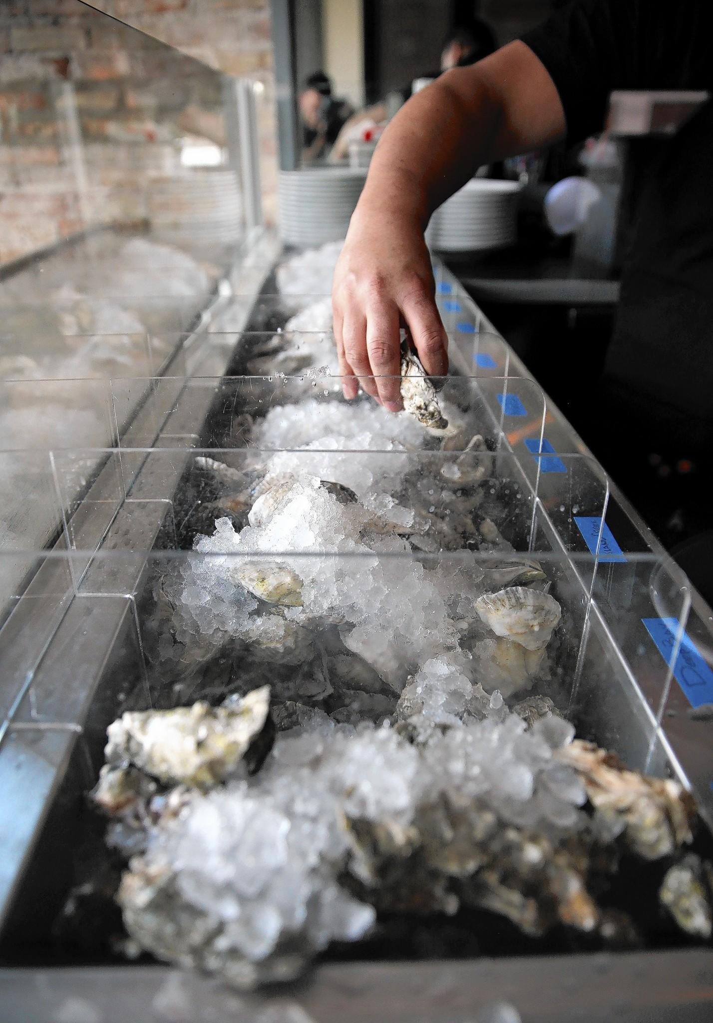 The staff prepares the day's oyster bar at Bow & Stern.