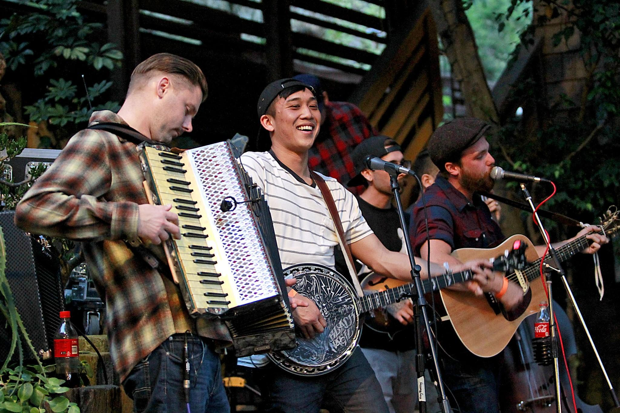 Vinne and the Hooligan's Scott Young, Mike Pham, and Vinnie Carlini, jam during the 2014 Blue Water Music Festival at the Sawdust on Saturday.