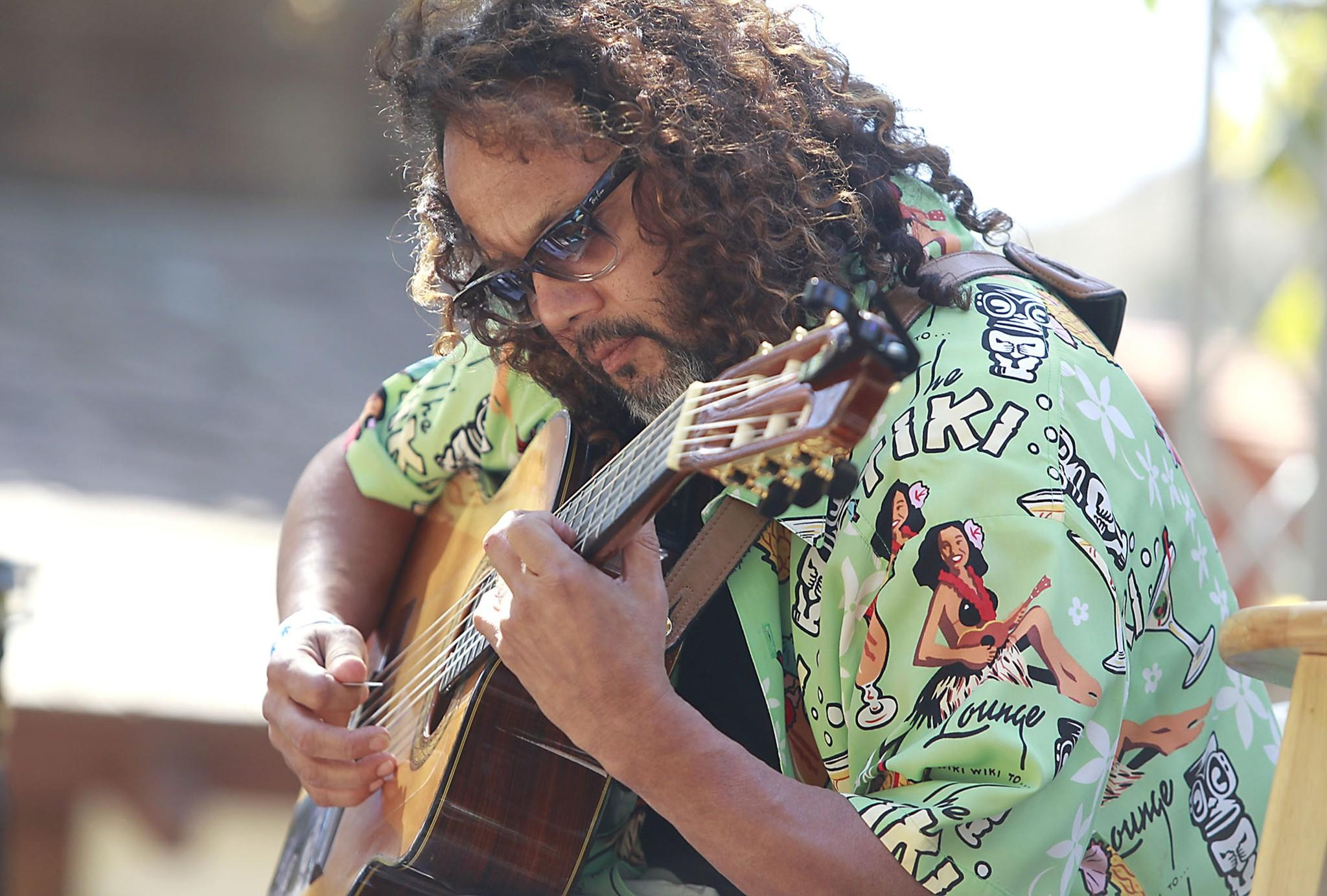 Local guitarist and performer Ken Garcia brought his Latin groove to the main stage during the 2014 Blue Water Music Festival at the Sawdust on Sunday.