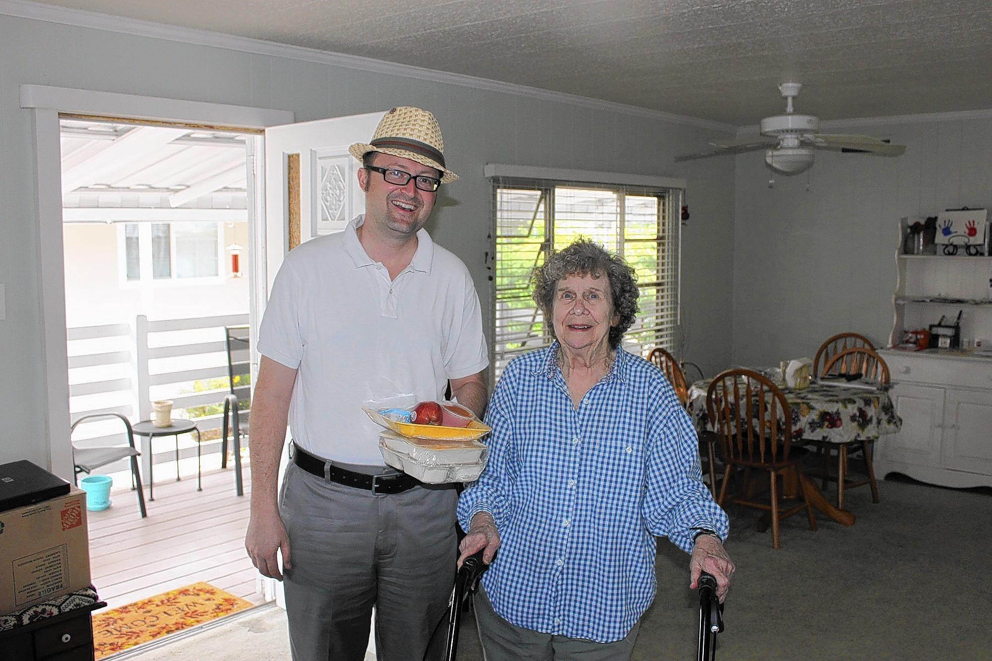 Huntington Beach Mayor Matthew Harper, left, helped deliver meals to homebound seniors as part of the Meals on Wheels program's Community Champions Week.