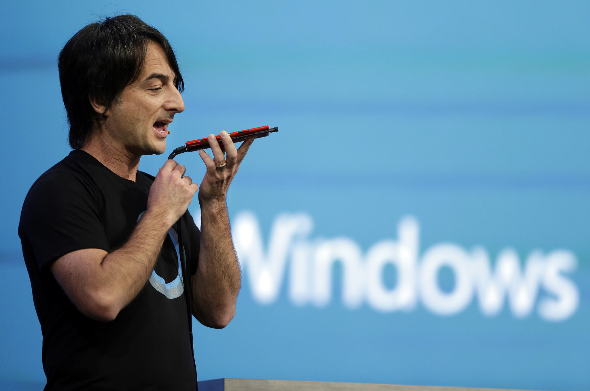 Microsoft corporate Vice President Joe Belfiore of the operating systems group demonstrates the new Cortana personal assistant during the keynote address of the Build Conference on Wednesday.