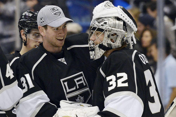 Kings goalie Jonathan Quick celebrates with backup Martin Jones after a 4-2 win over Winnipeg on Saturday.