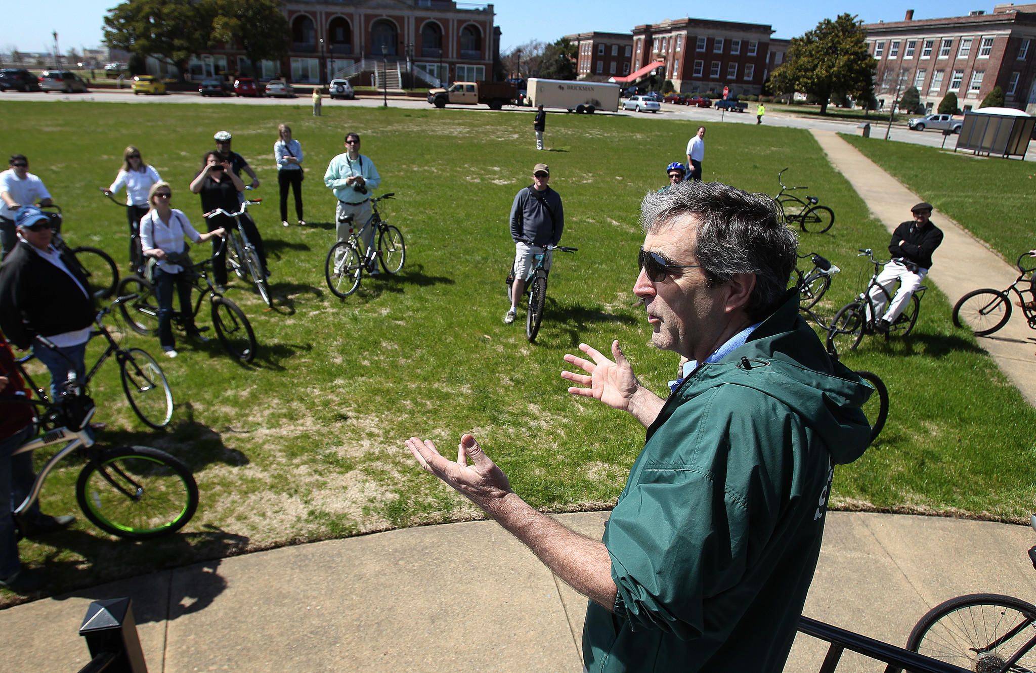 Fort Monroe authority director Glenn Oder discusses improvements to the green-spaces on the fort with local landscape architects during a bike tour Wednesday.