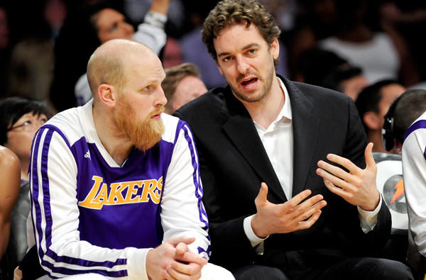 Lakers center Chris Kaman, left and might join power forward Pau Gasol in street clothes for the game Wednesday night against the Sacramento Kings.