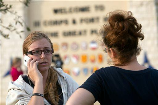 Krystina Cassidy, left, and Dianna Simpson try to contact their husbands after Ft. Hood was locked down because of the shooting.