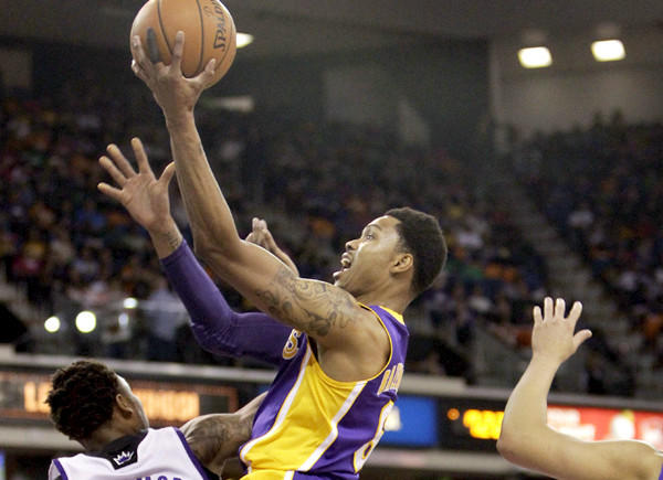 Lakers guard Kent Bazemore elevates over Kings guard Ben McLemore for a layup in the first half Wednesday night in Sacramento.
