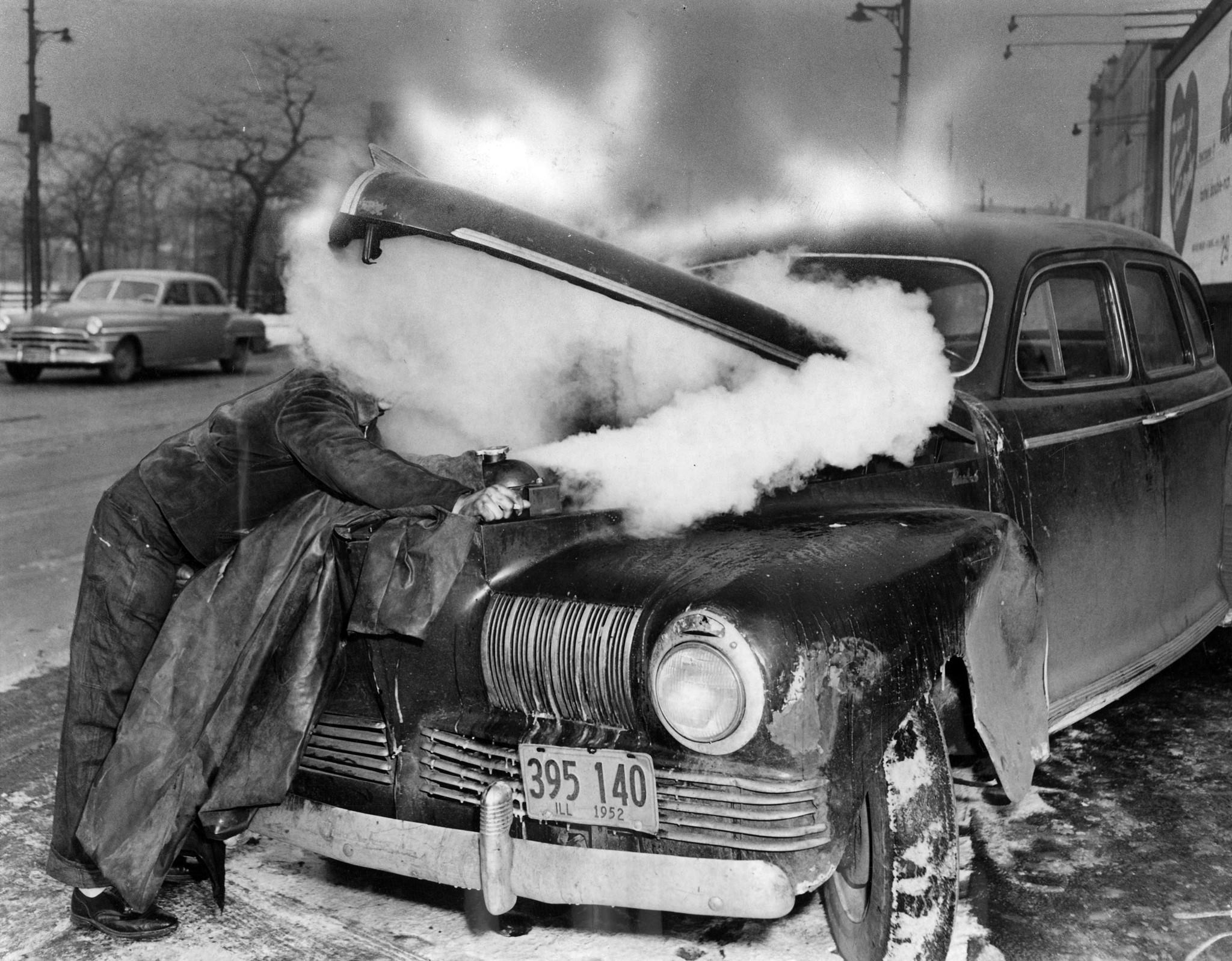 Lawrence Kulik, shrouded by steam from his boiling radiator, got caught with low anti-freeze in near zero cold at Ogden Ave. and Washington Blvd. on Jan. 24, 1952, in Chicago.