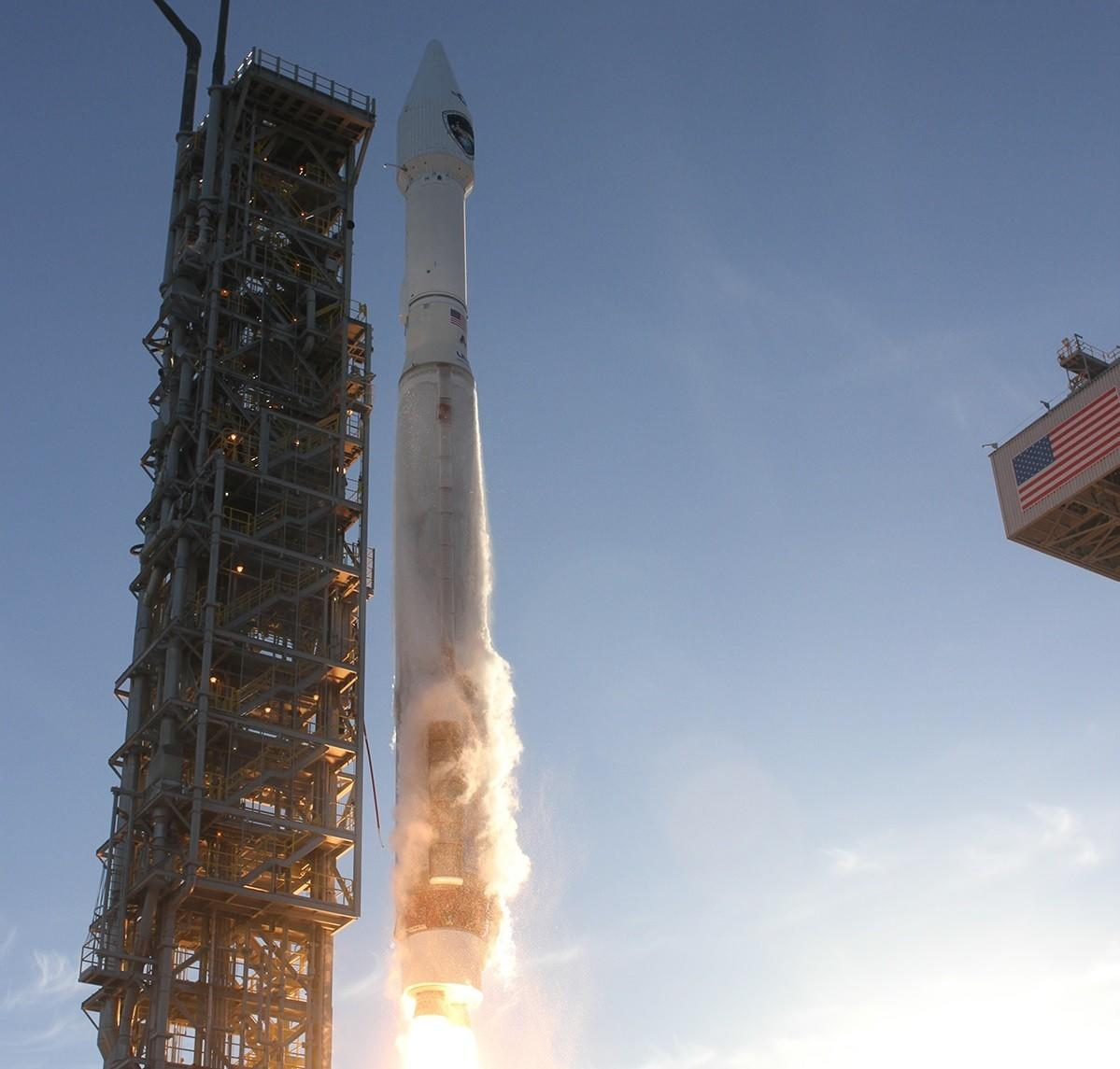 An Atlas V rocket blasts off from Vandenberg Air Force Base, carrying a military weather satellite.