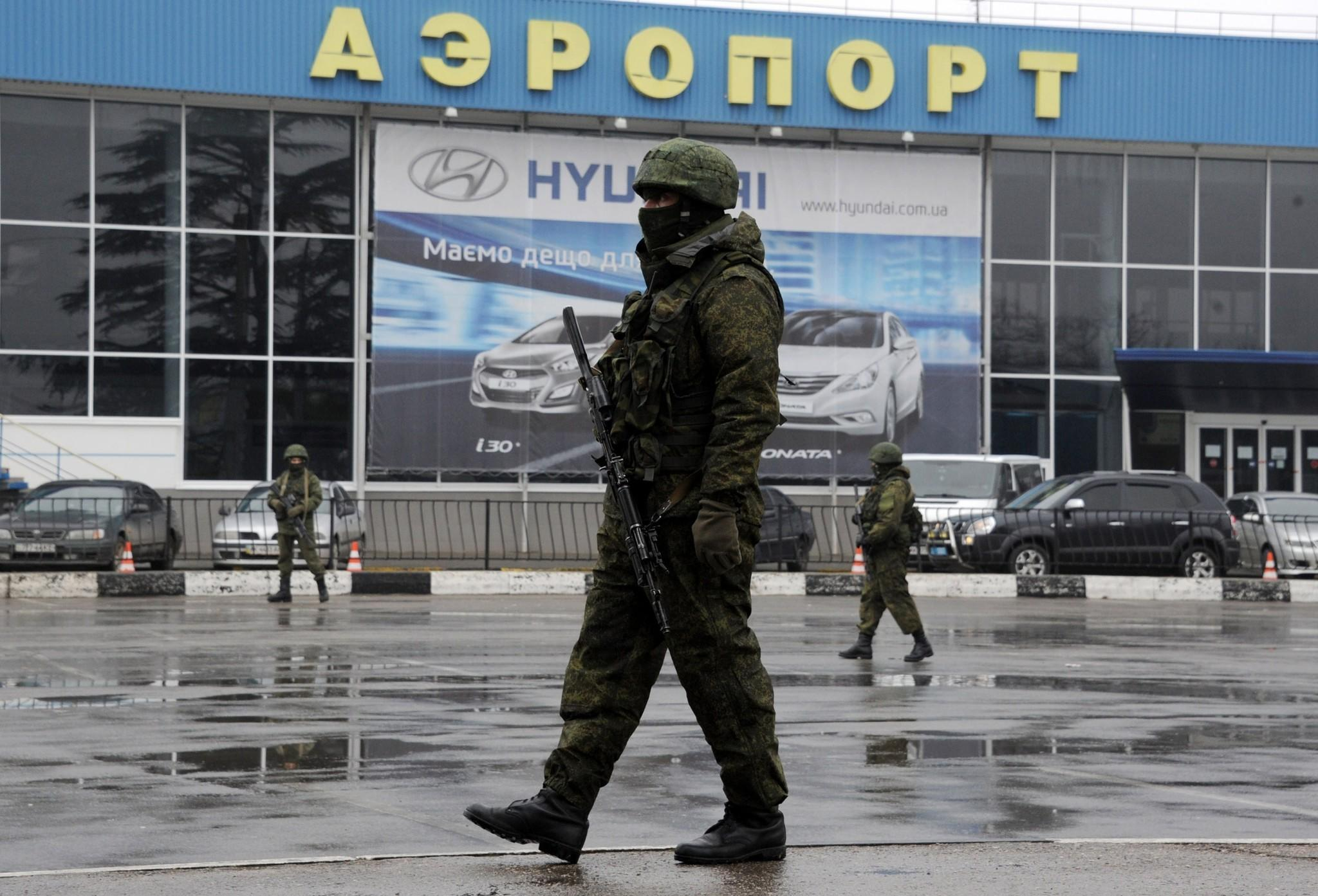 Russian troops seized control of Crimea's civilian international airport in Simferopol in late February, and the Russian government has proclaimed its takeover of air traffic control responsibility, effective Thursday, prompting a warning by the European Aviation Safety Agency of potential risks to civil aviation in the disputed region.