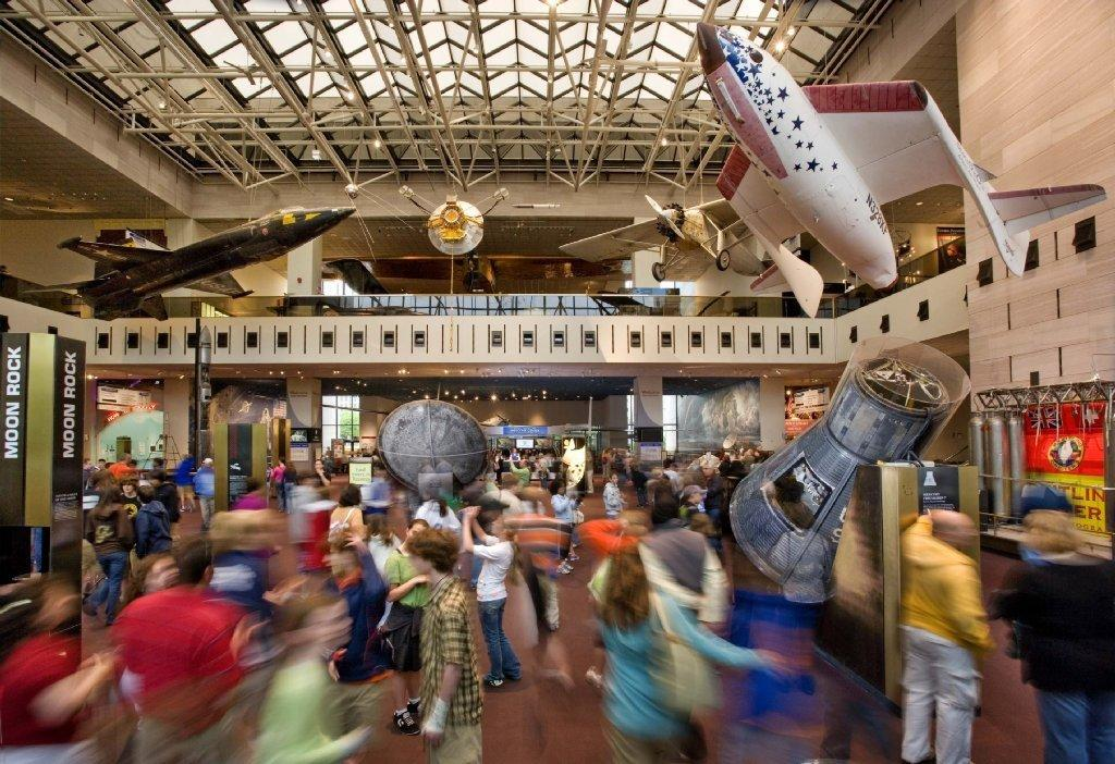 Visitors enjoy the Milestones of Flight Gallery, the main hall of the Smithsonian's National Air and Space Museum, in Washington.