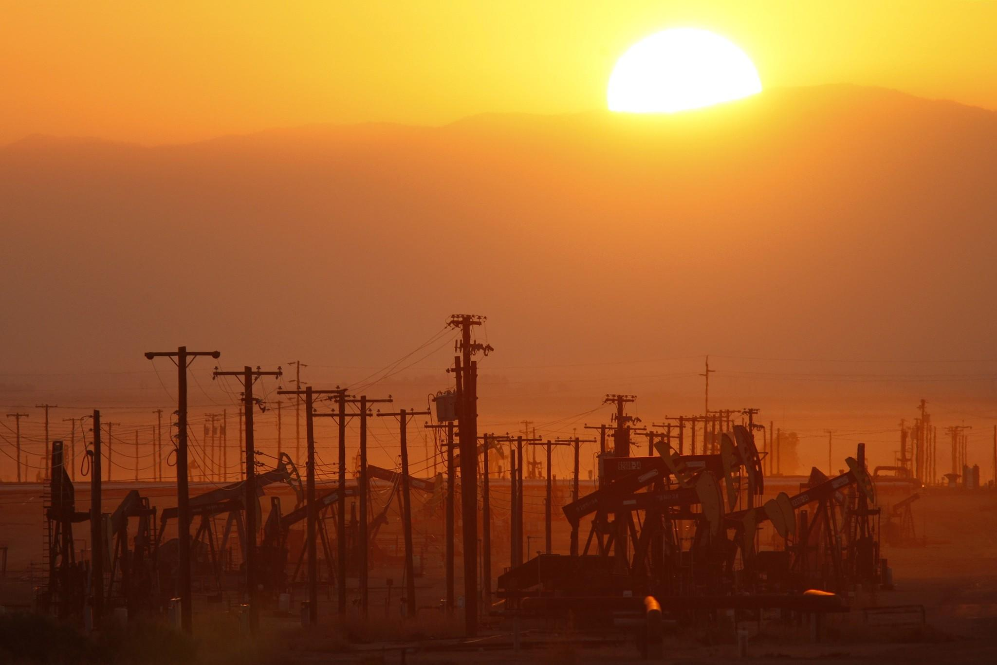 LOST HILLS, CA - MARCH 24: The sun rises over an oil field over the Monterey Shale formation where gas and oil extraction using hydraulic fracturing, or fracking, is on the verge of a boom on March 24, 2014 near Lost Hills, California. Critics of fracking in California cite concerns over water usage and possible chemical pollution of ground water sources as California farmers are forced to leave unprecedented expanses of fields fallow in one of the worst droughts in California history. Concerns also include the possibility of earthquakes triggered by the fracking process which injects water, sand and various chemicals under high pressure into the ground to break the rock to release oil and gas for extraction though a well. The 800-mile-long San Andreas Fault runs north and south on the western side of the Monterey Formation in the Central Valley and is thought to be the most dangerous fault in the nation. Proponents of the fracking boom saying that the expansion of petroleum extraction is good for the economy and security by developing more domestic energy sources and increasing gas and oil exports.