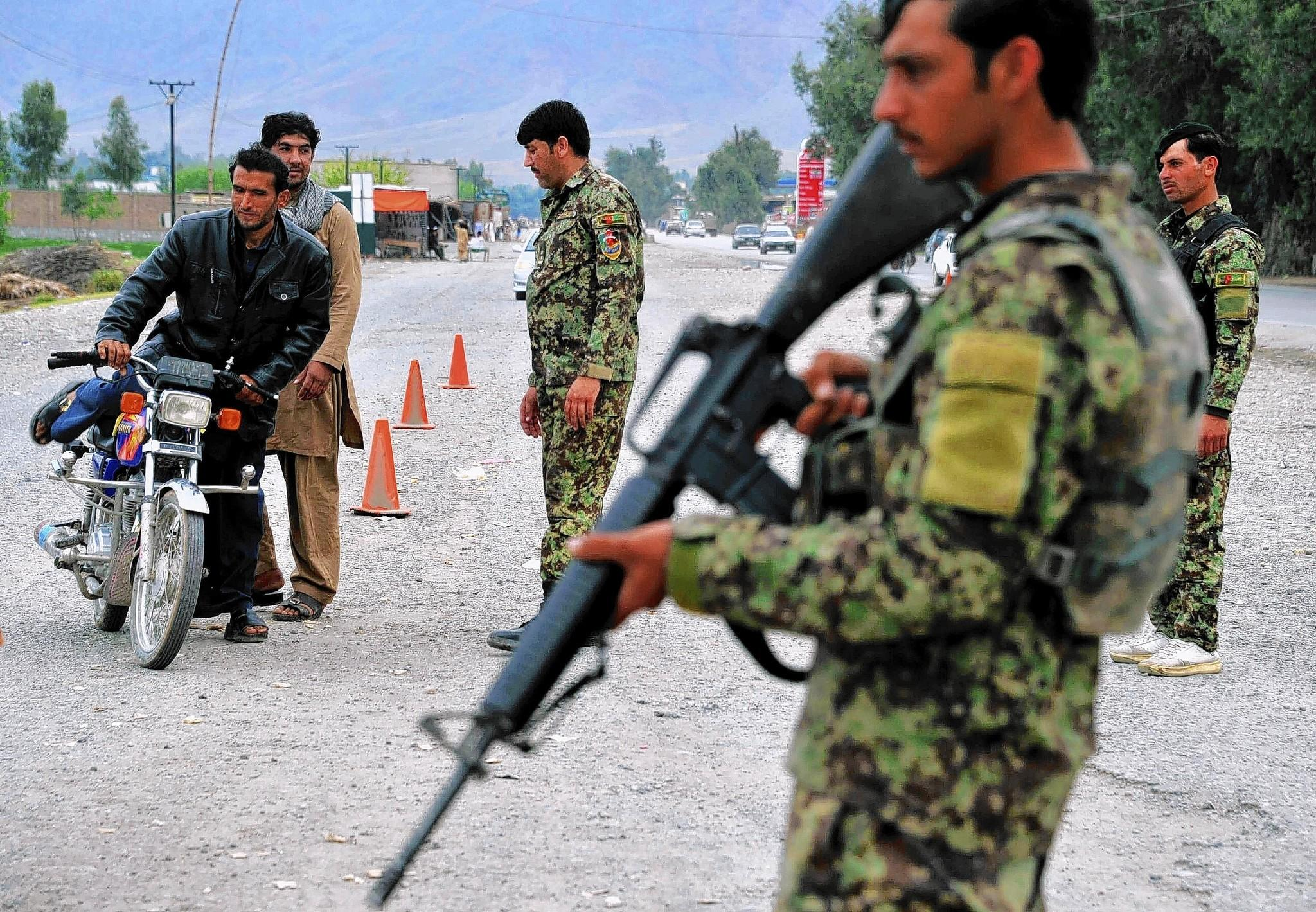 Afghans encounter a checkpoint in the eastern city of Jalalabad. Afghan soldiers and police are responsible for security in the nation's presidential election Saturday.