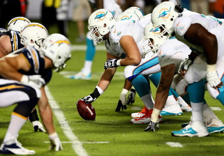 The offensive line of the Miami Dolphins lines up for a play against the San Diego Chargers during their game at Sun Life Stadium on November 17, 2013 in Miami Gardens, Florida. (