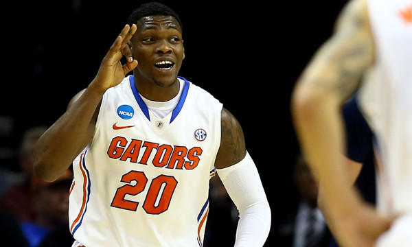 Florida's Michael Frazier II celebrates after hitting a shot in an NCAA tournament win over UCLA. Frazier's ability to be a constant scoring threat from the perimeter isn't the only characteristic that sets him apart from many other college basketball players.