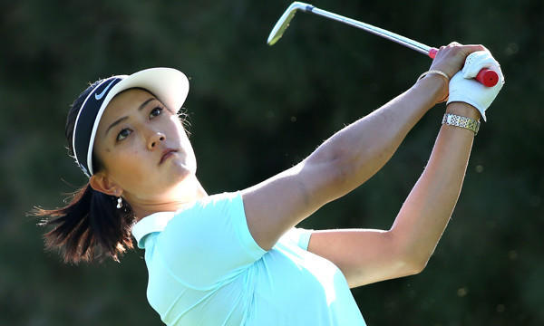 Michelle Wie hits her tee shot on the 17th hole during the first round of the Kraft Nabisco Championship at Mission Hills Country Club in Rancho Mirage on Thursday.