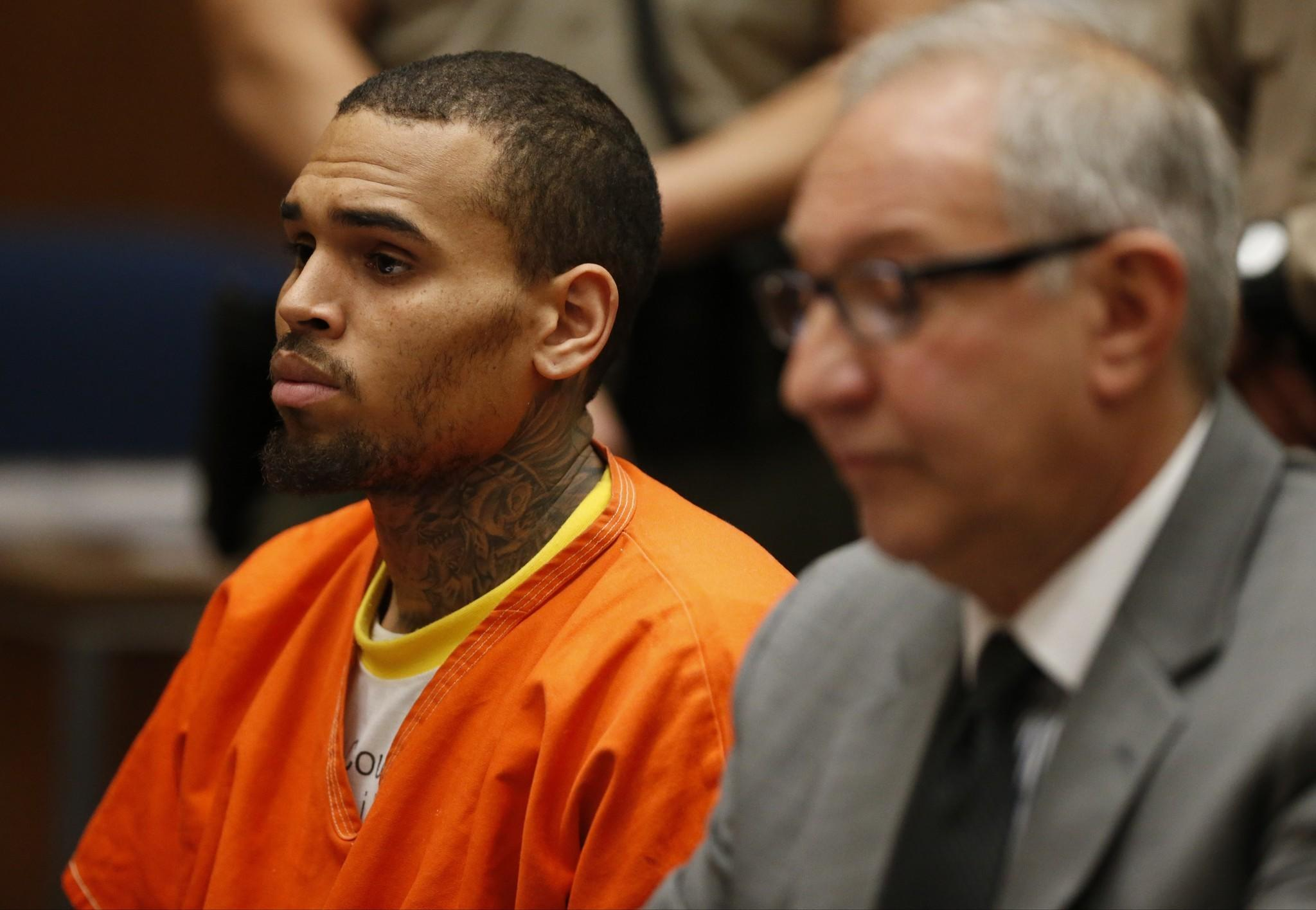 Singer Chris Brown, left, appears with attorney Mark Geragos at a court hearing in Los Angeles.