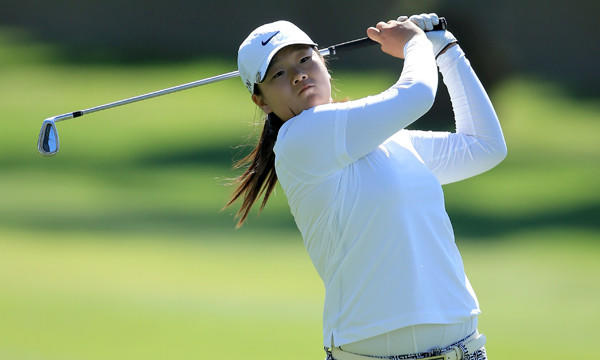 Amateur Angel Yin hits her second shot on the 15th hole during the first round of the Kraft Nabisco Championship at Mission Hills Country Club in Rancho Mirage on Thursday.