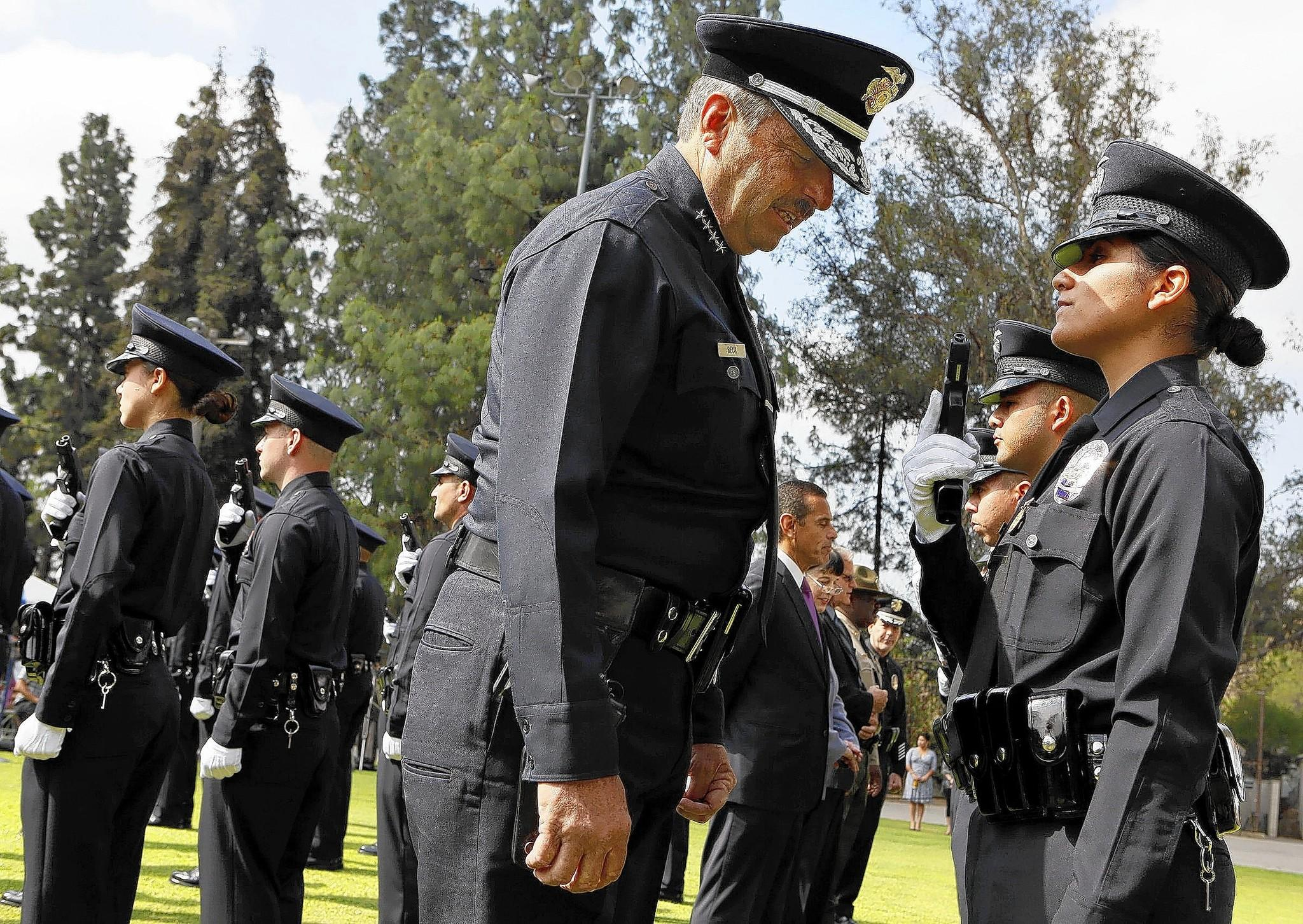 LAPD Chief Charlie Beck inspects the graduating class of recruits during a ceremony in 2012.