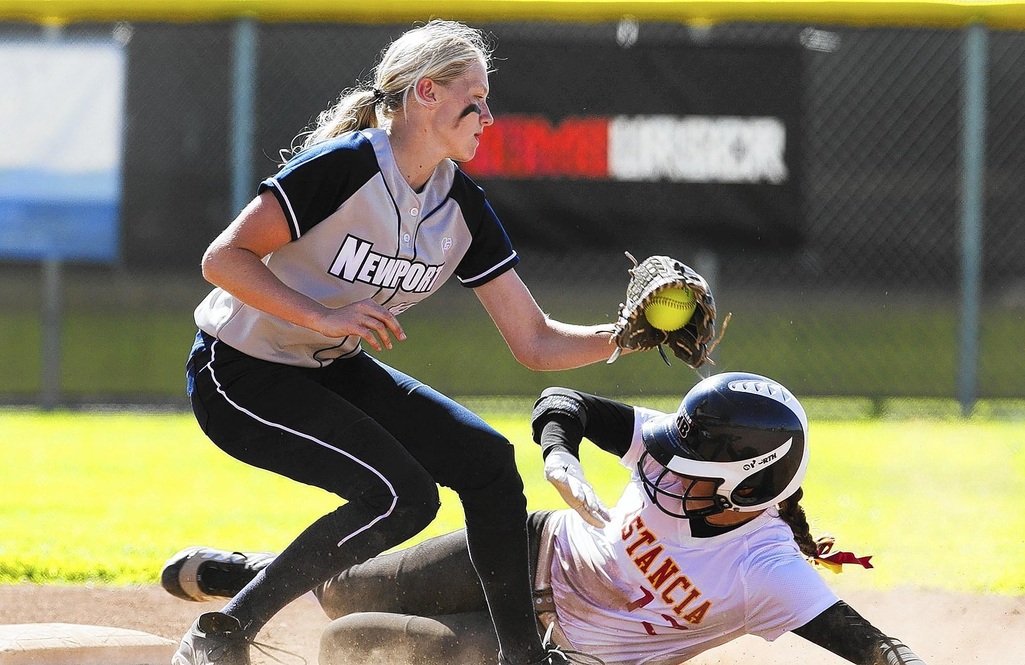 Estancia High's Gianna Guyot, right, slides under the tag of Newport Harbor's Diana Surber during a nonleague game on Thursday. (Scott Smeltzer - Daily Pilot)
