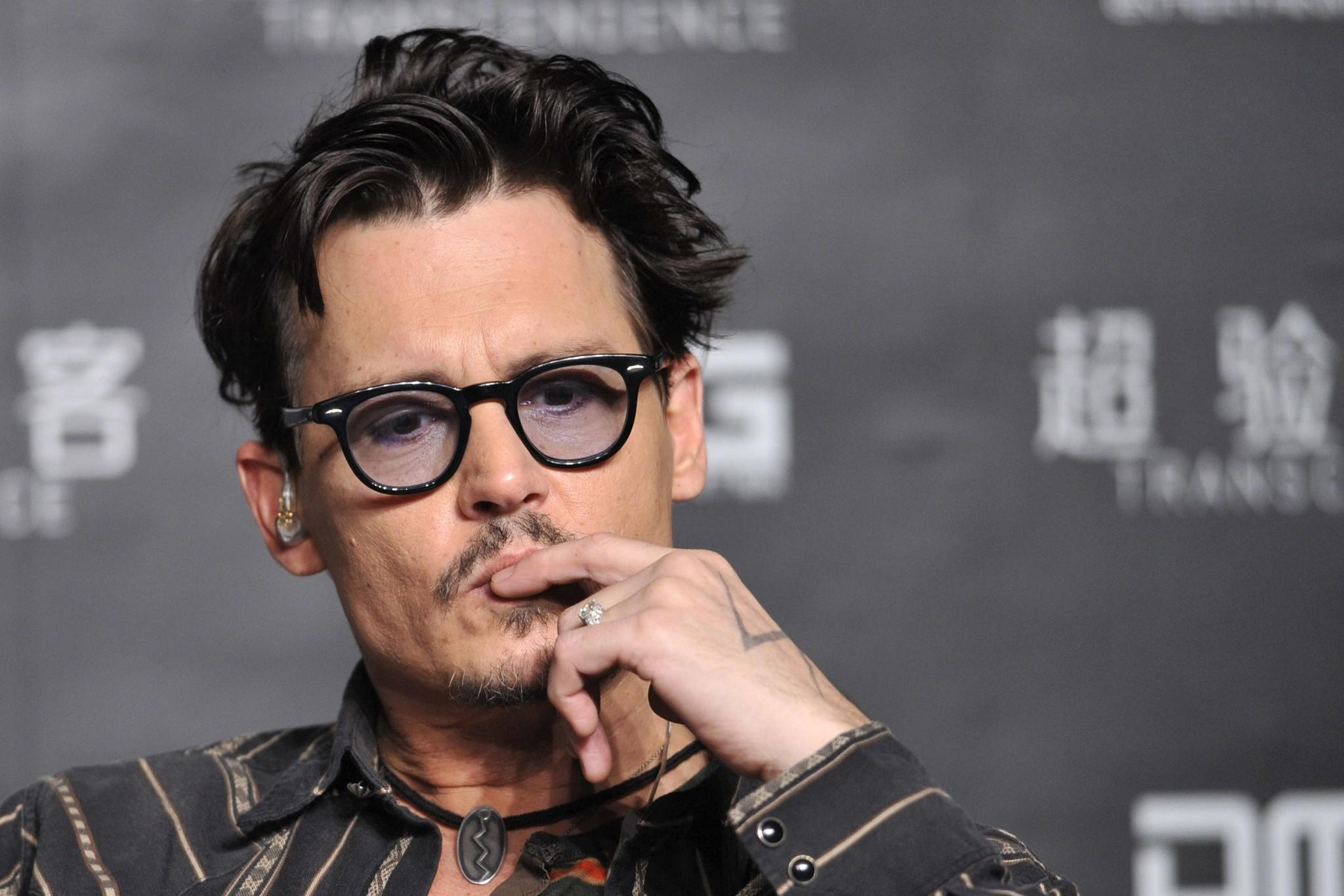 "Actor Johnny Depp attends a promotional event of his new movie ""Transcendence"", on his first visit to China."