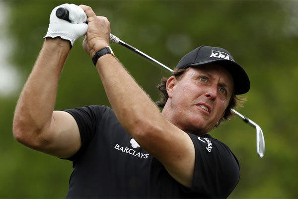 Phil Mickelson watches his tee shot on the ninth hole during the first round of the Shell Houston Open at the Golf Club of Houston on Thursday.